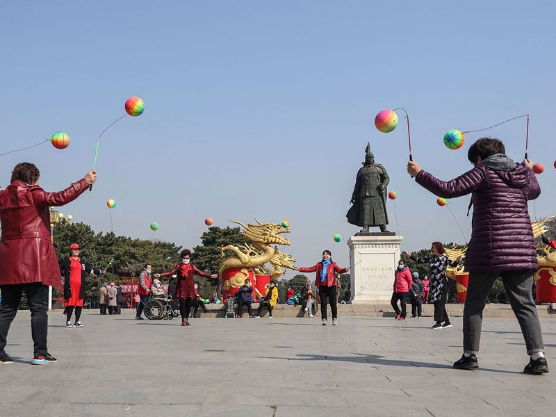 Residents playing at a park in Shenyang in China's northeastern Liaoning province.