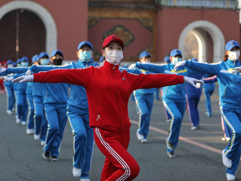 This photo shows residents wearing face masks while dancing at a park in Shenyang in China's northeastern Liaoning province. China on April 7 reported no new COVID-19 coronavirus deaths for the first time since it started publishing figures in January, the National Health Commission said.