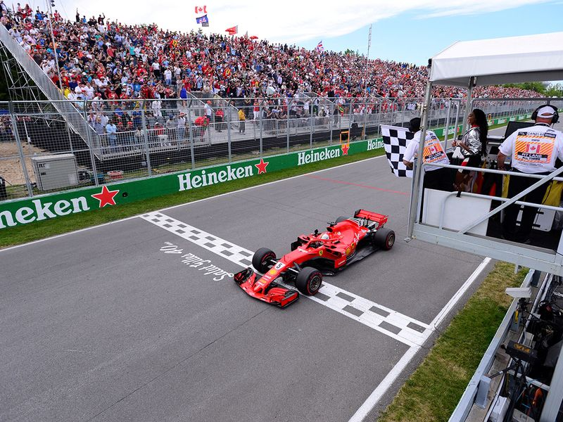Ferrari's Sebastian Vettel passes the chequered flag to win the race   Paul Chiasson/Pool via REUTERS/File Photo