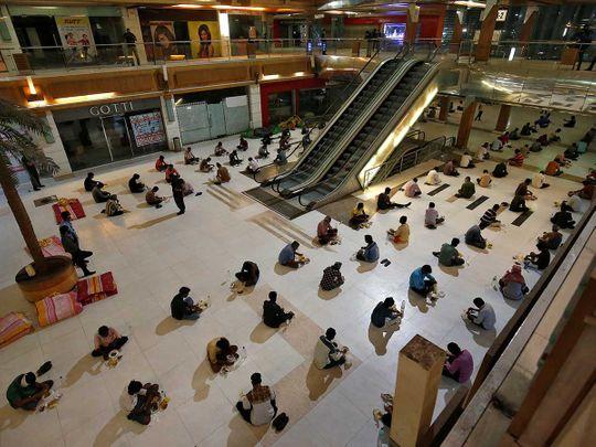 India migrant workers shopping mall coronavirus