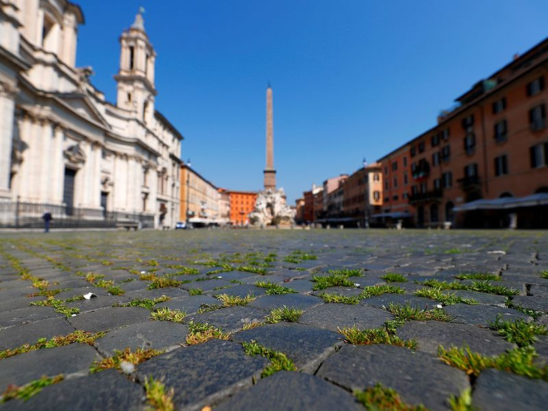 Grass grows on Rome's popular Piazza Navona square after a huge drop in the number of visitors due to a strict lockdown trying to stop the spread of COVID-19 in Rome, Italy.