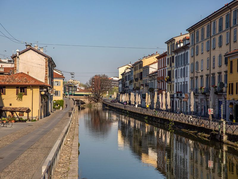 Parasols for closed cafes line the Navigli canal system in Milan, Italy. Italy is beginning to look at easing its lockdown after Denmark and Austria became the first two European countries to loosen restrictions as governments seek to gradually revive economies crippled by the containment measures without risking a second wave of infection.