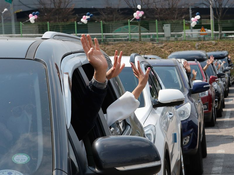 Christians inside cars pray during a drive-in worship service to celebrate an Easter at a public parking lot in Seoul, South Korea,on Sunday.
