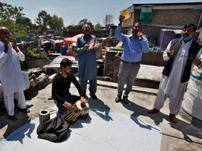 Pastor Barnabas Younis, second from right, leads a special Easter service from the rooftop of his house due to a government-imposed lockdown to help stop the spread of the new coronavirus, at a Christian neighborhood of Islamabad, Pakistan.