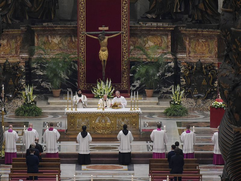 Pope Francis presides over a solemn Easter vigil ceremony in St. Peter's Basilica empty of the faithful following Italy's ban on gatherings to contain coronavirus contagion, at the Vatican.