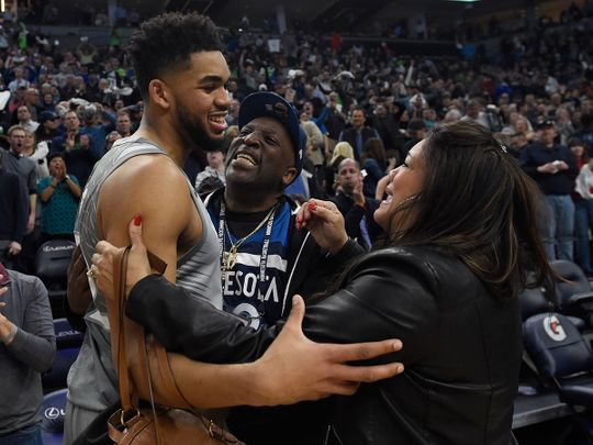 Karl-Anthony Towns of the Minnesota Timberwolves hugs his parents, Karl and Jackie Towns