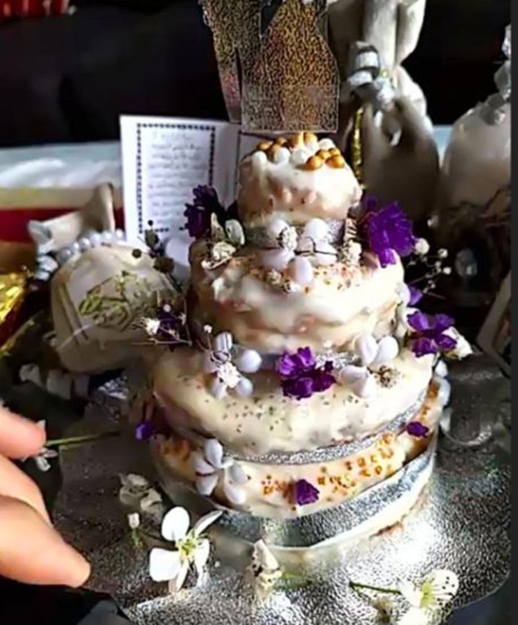 One of the bride's friends in the US had baked a wedding cake. There was a virtual cake cutting ceremony.