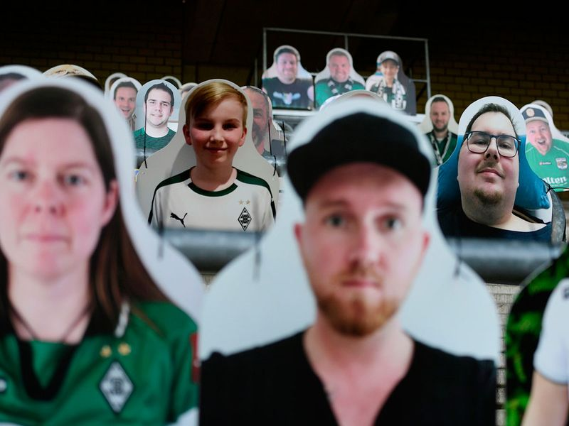 Cardboard cut-outs with portraits