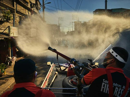 Manila Firefighters spray disinfectant lockdown Luzon