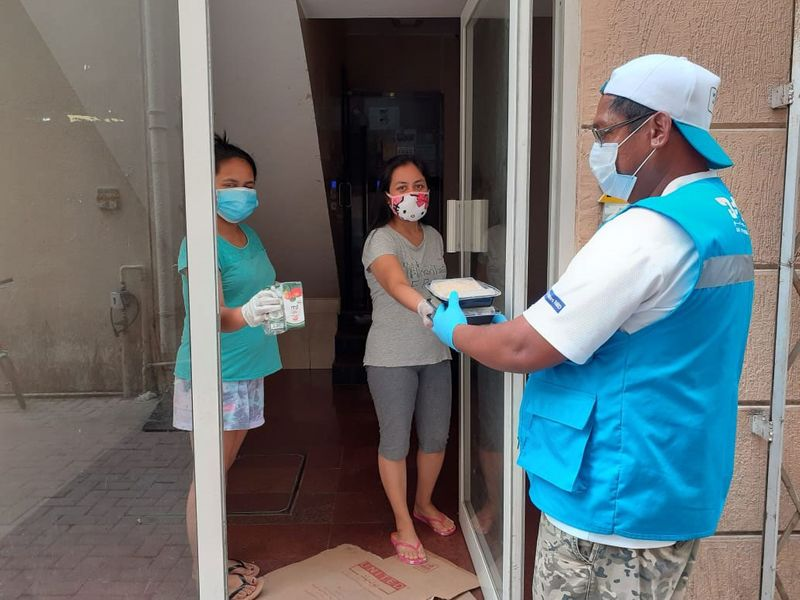 Volunteers hand out provisions in Dubai