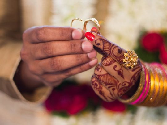 Couple in India get married despite lockdown, wearing masks