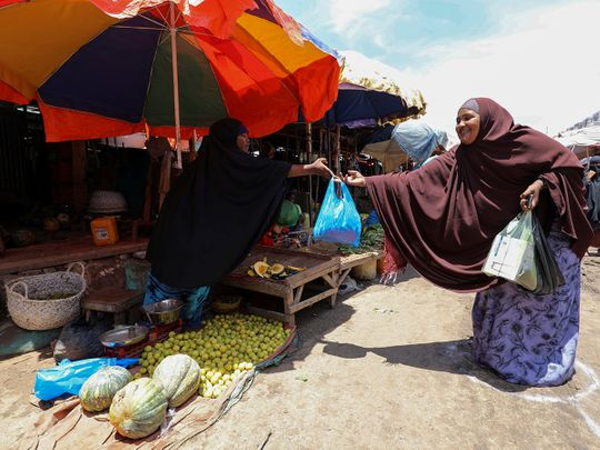 A woman sells fruits t