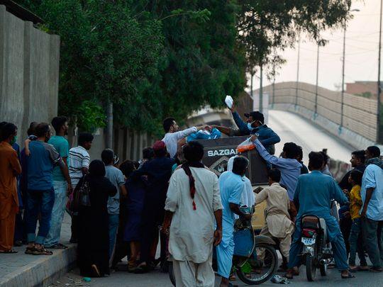 Men distribute food