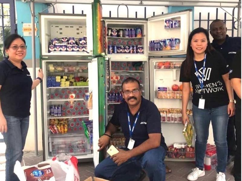 Volunteers with the sharing fridges