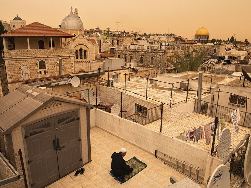 A man prays on a rooftop during Ramadan afternoon prayers in Jerusalem. For the world's 1.8 billion Muslims, the holy month of Ramadan is a social and spiritual high point of the year, a time to gather with friends and family and to focus on fasting and prayers But the COVID-19 pandemic is transforming this Ramadan in unprecedented ways in societies across the globe, clearing out mosques, cancelling communal prayers and forcing families to replace physical gatherings with virtual meet-ups.