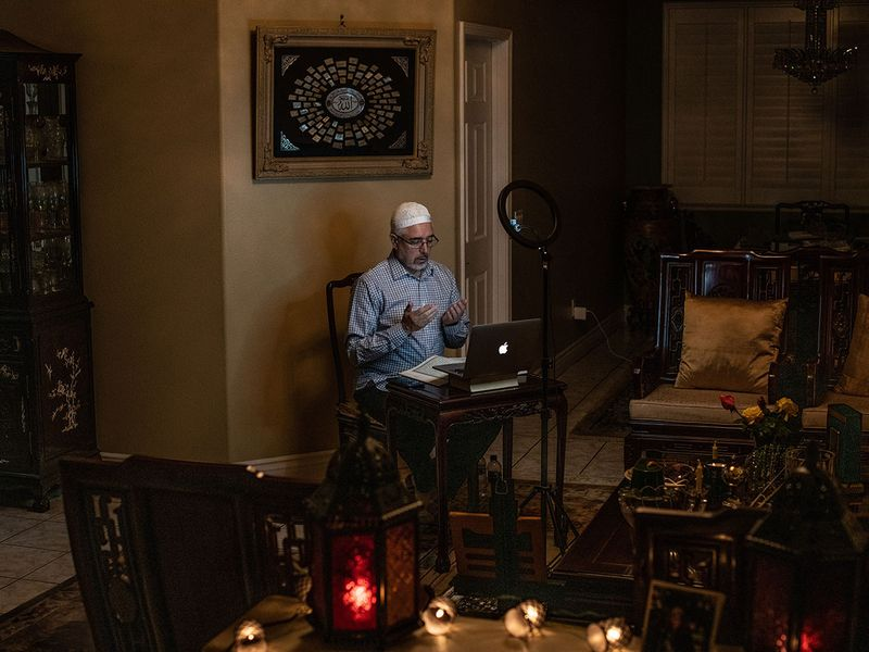 Dr. Saleh Kholaki, the chairman of the religious committee at the Islamic Center of Southern California, leads members of the Mosque community in prayer via online live-streaming during Ramadan, from his home in La Crescenta, California.