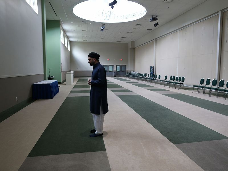 Umair Khan, the Imam of the largest mosque in British Columbia, the Baitur Rahman Mosque, prays alone during the holy fasting month of Ramadan amid COVID-19 restrictions in Delta, British Columbia, Canada.