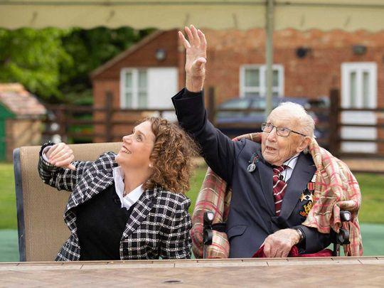 Second World War veteran Captain Tom Moore with his daughter Hannah walk garden