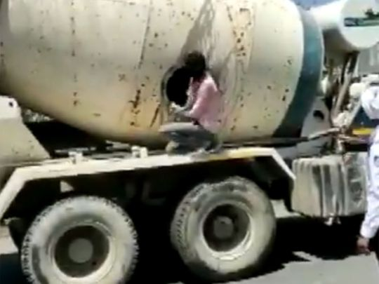 Watch: 18 people found travelling in concrete mixer truck in Indore