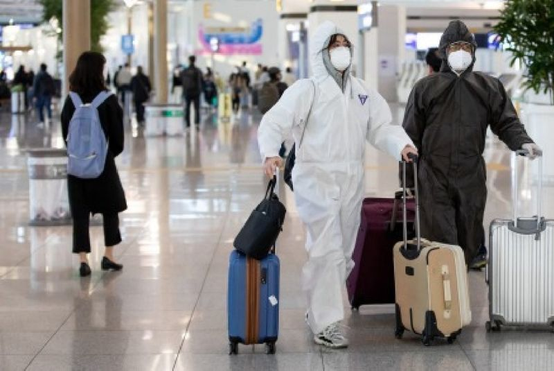 Travelers wearing protective masks