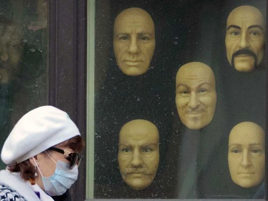 A woman wearing a face mask Russia wax faces