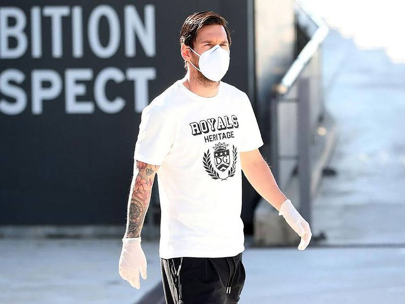 Barcelona's Argentine forward Lionel Messi wearing a face mask and gloves at the Ciutat Esportiva Joan Gamper in Sant Joan Despi near Barcelona on May 6