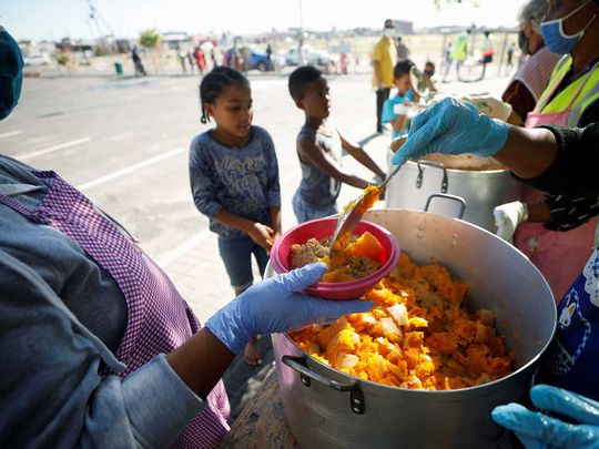 Children queue for food South Africa Cape town