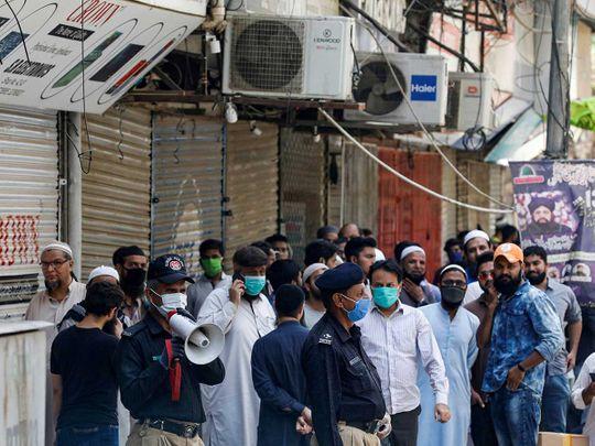 Police pakistan shopkeepers Karachi