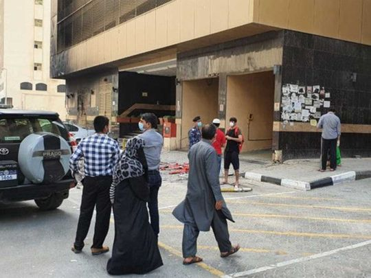 Residents outside the fire-hit Abbco Tower in Sharjah