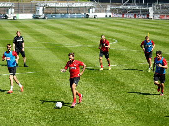 Cologne's Marco Hoger with teammates during training this week