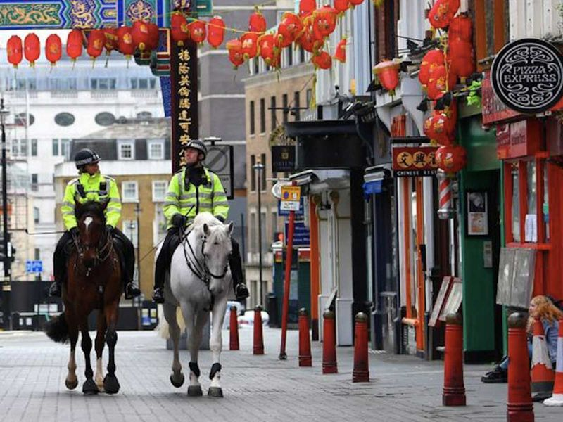 Mounted police officers patrol the Chinatown Soho
