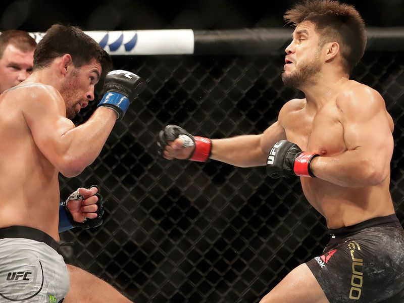 Henry Cejudo, right, punches Dominick Cruz during their UFC 249 fight