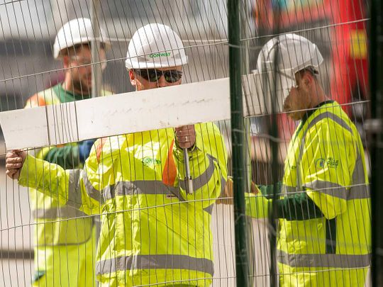 UK Construction workers erect fencing on London Bridge in London