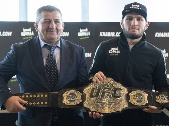 Abdulmanap Nurmagomedov, the father and longtime trainer of UFC star Khabib Nurmagomedov, with his son