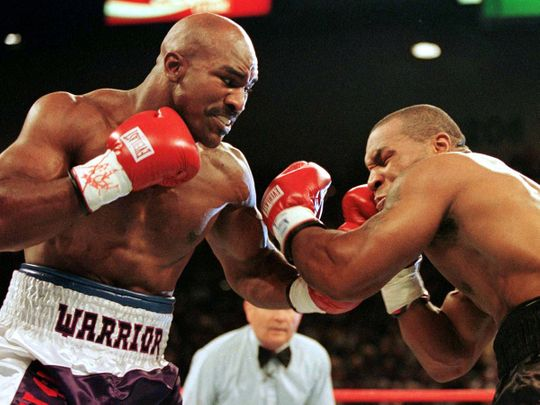 Evander Holyfield connects to the jaw of Mike Tyson in the first round of their title fight June 28 1997.  Evander Holyfied retained his World Boxing Association heavyweight title on Saturday night when Mike Tyson was disqualified for biting Holyfield twice in the third round.