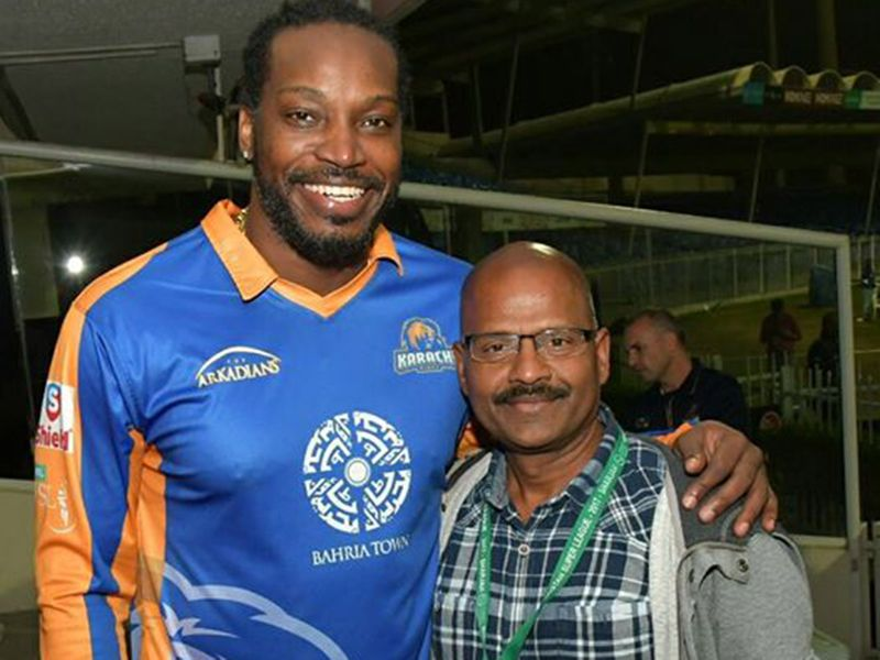 Saleem with cricket superstar Chris Gayle