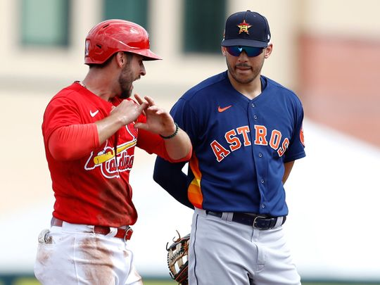 St Louis Cardinals' Paul DeJong, left, talks to Houston Astros shortstop Carlos Correa during a spring training baseball game before the coronavirus lockdown.