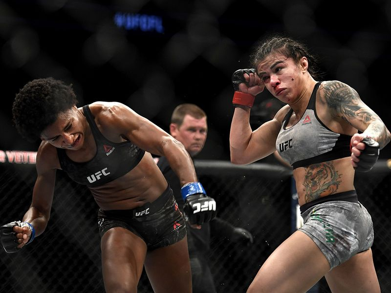 Claudia Gadelha (R) fights Angela Hill (L) in their strawweight bout during UFC Fight Night at VyStar Veterans Memorial Arena in Jacksonville, Florida.
