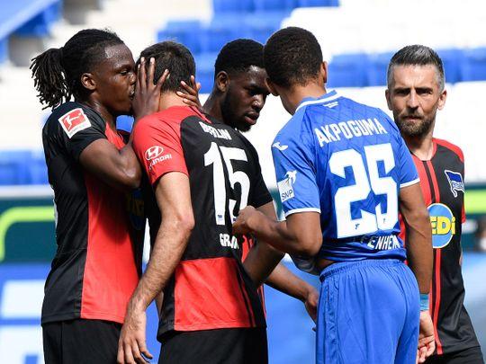 Hertha Berlin's Dedryck Boyata, left, celebrates with Marko Grujic during the Bundesliga win over Hoffenheim