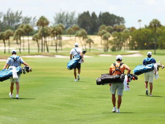 From left: Rory McIlroy and Dustin Johnson of the American Nurses Foundation team, and Rickie Fowler and Matthew Wolff of the CDC Foundation team carry their own bags on the fanless course.