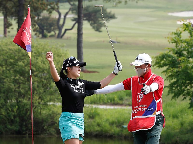 Park Hyun-kyung, left, of South Korea celebrates with her caddie after winning the KLPGA Championship on the 18th hole at the Lakewood Country Club in Yangju, South Korea, Sunday, May 17, 2020. (AP Photo/Ahn Young-joon)