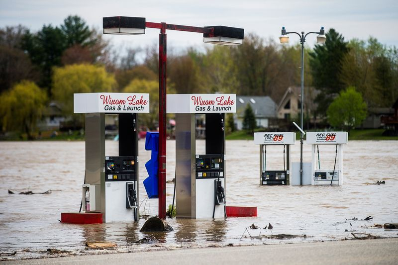 Floodwater surrounds gas pumps at Wixom Lake Gas & Launch, along the Tittabawassee River in Beaverton.