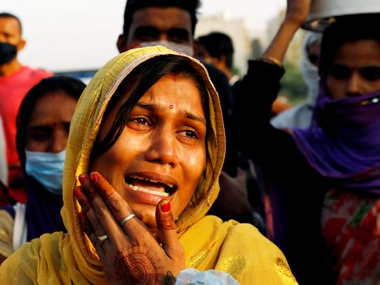 Indian migrant woman cries