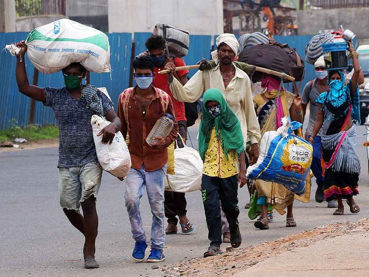 Migrants workers walk along the national-highway for their native places, Chhatisgarh, during the nationwide lockdown, in Bhubaneswar