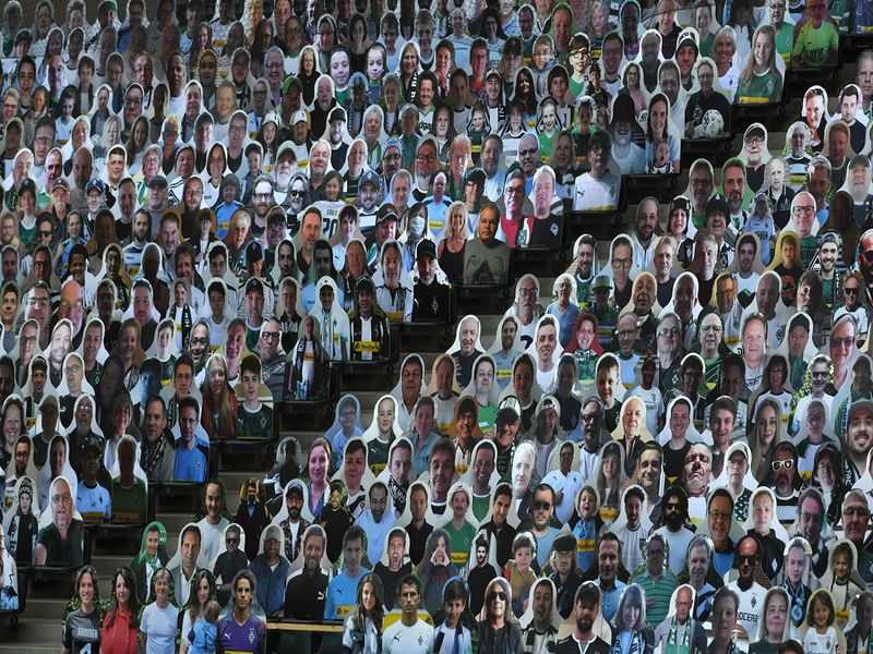 TOPSHOT - Cardboard cut-outs with portraits of Borussia Moenchegladbach's supporters are seen at the Borussia Park football stadium in Moenchengladbach, western Germany, on May 19, 2020, amid the novel coronavirus COVID-19 pandemic.   / AFP / Ina FASSBENDER