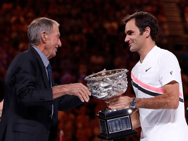 Ashley Cooper with Roger Federer.