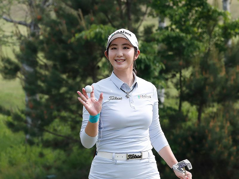 Bae Seon-woo of South Koreal waves on the 18th hole during the final round of the KLPGA Championship at the Lakewood Country Club in Yangju, South Korea, Sunday, May 17, 2020. (AP Photo/Ahn Young-joon)