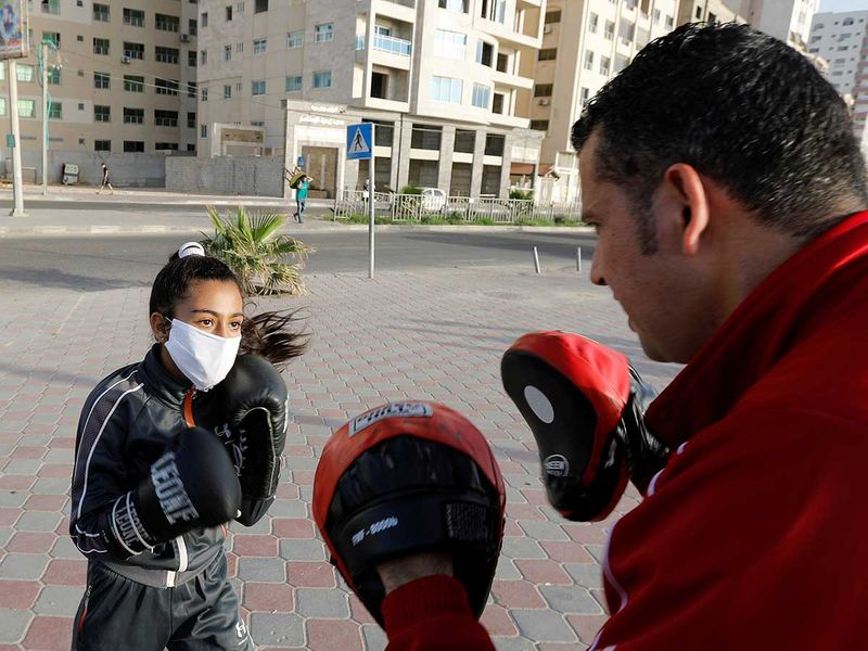Copy-of-2020-05-22T085547Z_2032979067_RC2KTG935WRN_RTRMADP_3_HEALTH-CORONAVIRUS-PALESTINIANS-BOXING-(Read-Only)