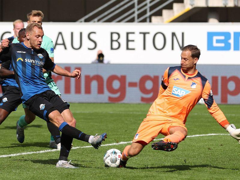 Paderborn midfielder Ben Zolinskiis beaten by Hoffenheim goalkeeper Oliver Baumann
