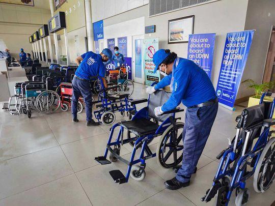 Airport PRayagraj India workers disinfect